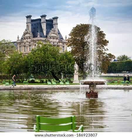 Tuileries Garden in Paris with Louvre and fountain - stock photo