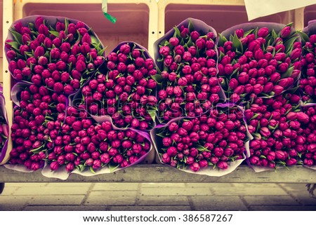 Tulip Bouquets on the Market for Sale with a Vintage Processing Filter - stock photo