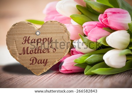 tulips and a sign for mother's day - stock photo