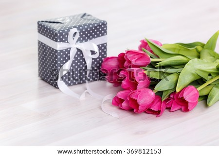 Tulips and boxes with gifts. On March 8, International Women's Day, Mother's Day - stock photo