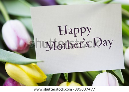 Tulips and card with Happy Mother's day on it. - stock photo