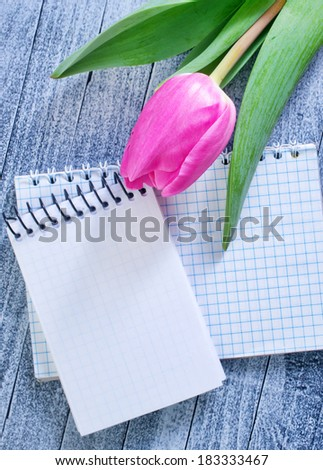 tulips and note - stock photo
