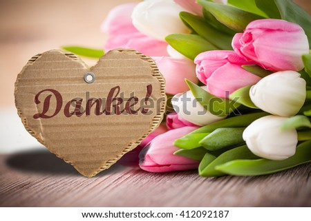 """tulips with message saying """"Thank you!"""" in German - stock photo"""
