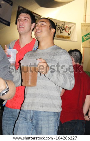 TULSA, OK - OCT 20: Party goers dance and drink beer at Oktoberfest in TULSA, OK, on October 20, 2011 in TULSA, OK. Tulsa is the origin of the first Oktoberfest Chicken Dance in the United States. - stock photo