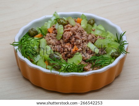 Tuna and celery salad with dill and capers - stock photo