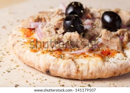 tuna and onion baby pizza - stock photo