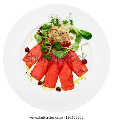 Tuna carpaccio on plate isolated on white background - stock photo