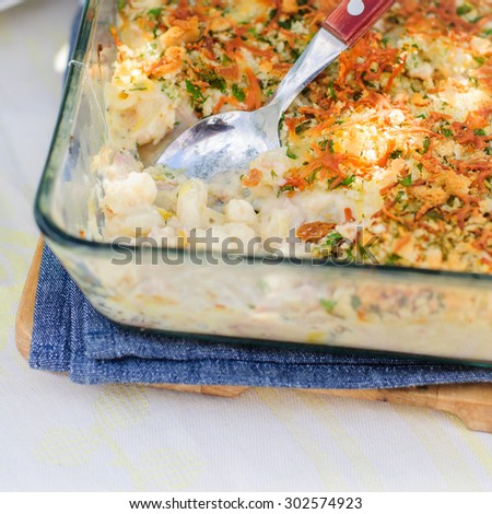 Tuna, Leek, Mornay and Orange Pasta Bake with Bread Crumb and Cheese Topping (Macaroni and Cheese), square, copy space for your text - stock photo