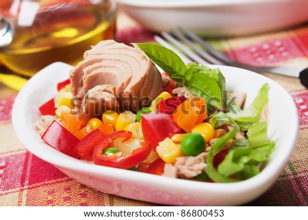 Tuna salad with corn, pepper, green peas and carrot - stock photo