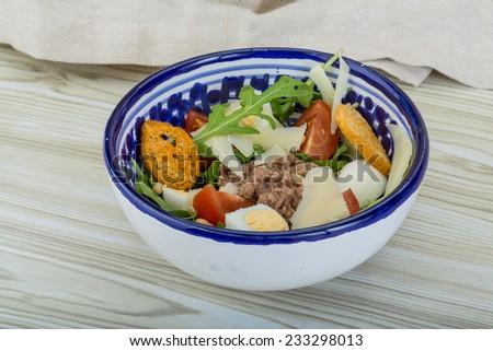 Tuna salad with ruccola and quail eggs - stock photo