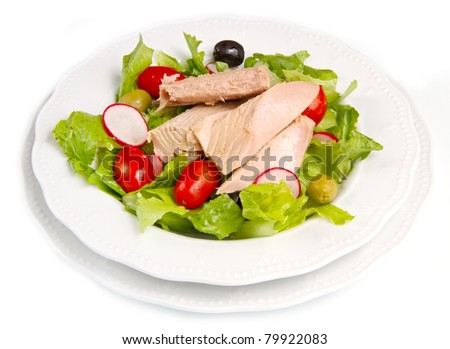 Tuna salad with tomatoes, olives and radish - stock photo