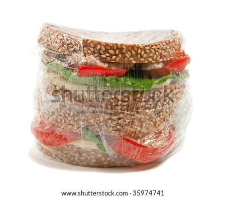 tuna sandwich in plastic wrap - stock photo