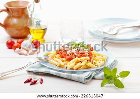 Tuna sauce half penne - stock photo