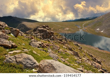Tundra scene along the trail from Summit Lake to the summit of Mount Evans in Colorado. - stock photo