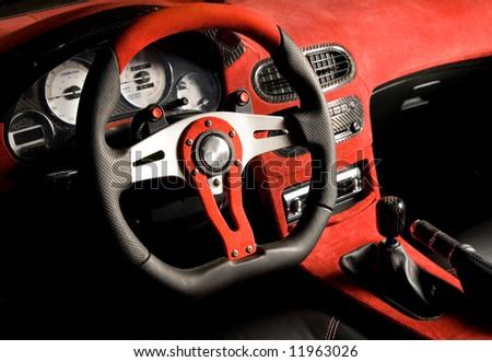 Tuned sport car. Luxury red velvet interior - stock photo