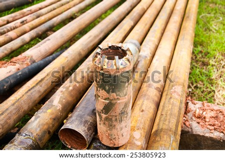 tungsten core bit and drilling pipe used in the mining industry and Coal Seam Gas drilling - stock photo