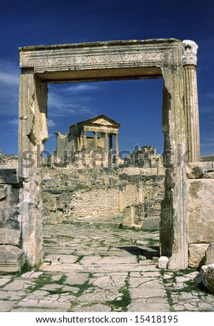 Tunisia. Ancient Dougga. The Capitole hilltop seen via doorframe from place of unidentified temple referred to as Dar el-Echab - stock photo