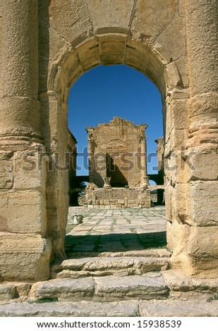 Tunisia. Ancient Sufetula (present day Sbeitla). Entrance to the forum via the triumphal arch - stock photo