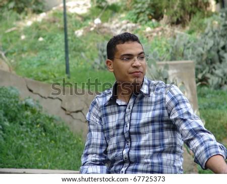 Tunisian man sitting in the tunisian forest. - stock photo