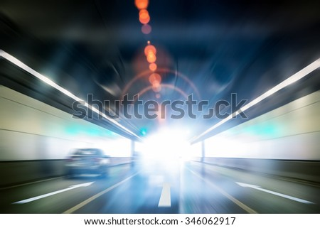 tunnel exit background, bright glowing light with motion blur - stock photo
