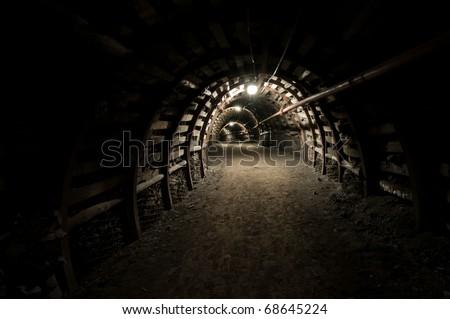 Tunnel in mine, reinforced passageway in coal mine. - stock photo