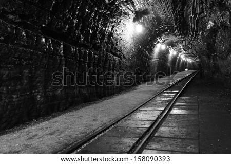 Tunnel in very old Polish salt mine Bochnia Wieliczka B&W - stock photo