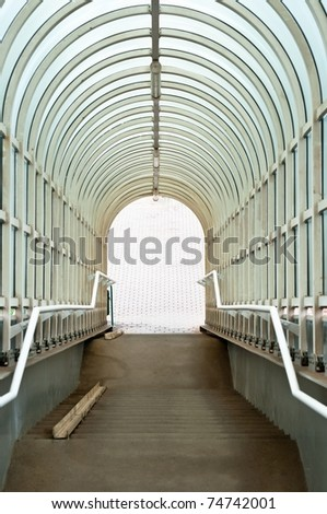 Tunnel leading down to the light - stock photo