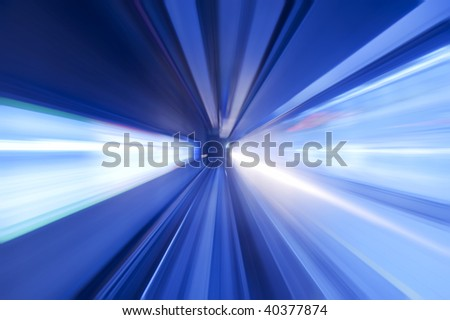Tunnel. Moving fast into blue tunnel. - stock photo