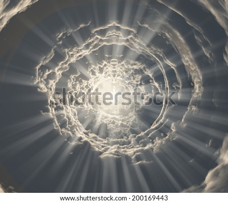 Tunnel of clouds with light - stock photo