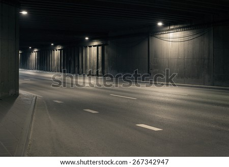 Tunnel road area with spotlights on the wall - stock photo