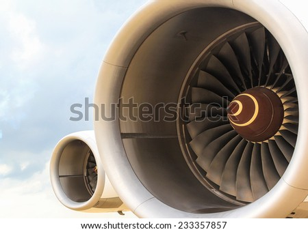 Turbine of airplane Wing and jet engine - stock photo