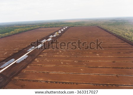 Turf extraction field prepared for turf collection and removal - stock photo