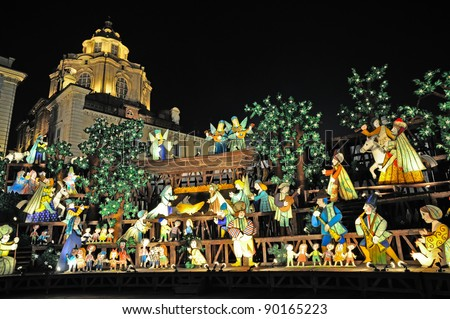 TURIN - DECEMBER 2: Outdoor nativity scene of life sized by Emanuele Luzzati in Castello square, urban centre, on December 2, 2011 Turin, Italy. - stock photo