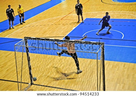 TURIN - FEBRUARY 4: Handball match in Serie B between Città Giardino Torino Vs Derthona. Unidentified player shot a penalty. February 4, 2012 Turin, Italy. - stock photo