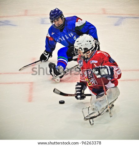 "TURIN - FEBRUARY 25: Unidentified players during qualification's match between Italy and Czech Republic. Ice Sledge Hockey tournament ""Città di Torino"" on February 25, 2012 Turin, Italy. - stock photo"