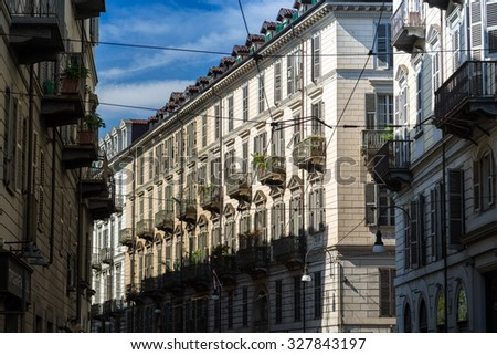 Turin historic building facade in downtown area - stock photo