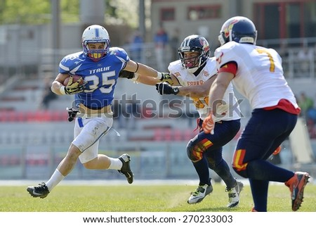 TURIN, ITALY - APRIL 12, 2015: CUOMO Valerio (left) run with ball. Italian U19 team win the qualifying match with Spain for European championship, in the Nebiolo Stadium in Turin. - stock photo
