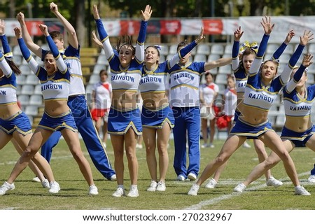 TURIN, ITALY - APRIL 12, 2015: Italian cheerleaders of Rainbow team exhibit during match interval of qualifying match Italy vs Spain for European championship, in the Nebiolo Stadium in Turin. - stock photo
