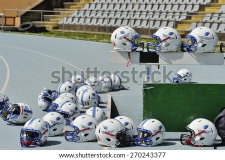 TURIN, ITALY - APRIL 12, 2015: TURIN, ITALY - APRIL 12, 2015: America football national team helmets before match before Italy vs Spain U19, in the Nebiolo Stadium in Turin. - stock photo