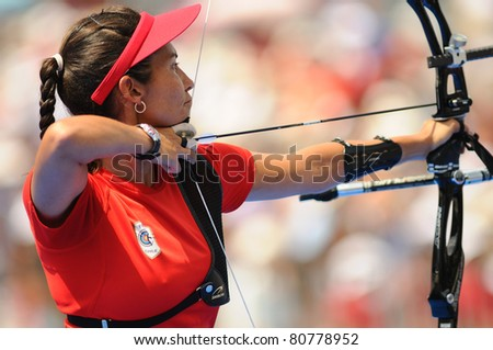 TURIN, ITALY-JULY 10: VAN LAMOEN Denisse (CHI), women recurve world champion, wins round for gold at 2011 World Archery and Para Archery Championships , on June 10, 2011 in Turin, Italy. - stock photo