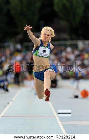 TURIN, ITALY - JUNE 10: Dzetsuk Kseniya (BLR) performs triple jump during the 2011 Memorial Primo Nebiolo track and field athletics international meeting, on June 10, 2011 in Turin, Italy. - stock photo