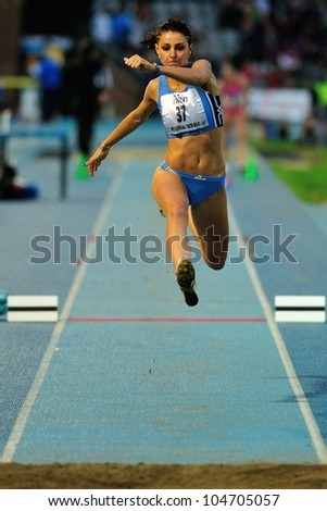TURIN, ITALY - JUNE 08: Eleonora D'Elicio ITA performs triple jump during the International Track & Field meeting Memorial Nebiolo 2012 on June 08, 2012 in Turin, Italy. - stock photo