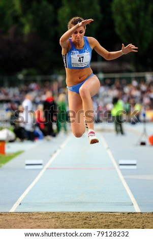 TURIN, ITALY - JUNE 10: Eleonora Delicio (ITA) performs triple jump during the 2011 Memorial Primo Nebiolo track and field athletics international meeting, on June 10, 2011 in Turin, Italy. - stock photo