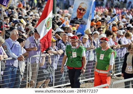 TURIN, ITALY - JUNE 21, 2015: Holy Father Pope Francesco Bergoglio visit Turin for the holy Shroud exhibition and the city cheers him with a joyful crowd in Vittorio Place. Volunteers at work. - stock photo