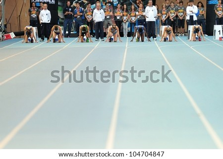 TURIN, ITALY - JUNE 08: Many athletes bolt off for 100m women sprint race during the International Track & Field meeting Memorial Nebiolo 2012 on June 08, 2012 in Turin, Italy. - stock photo