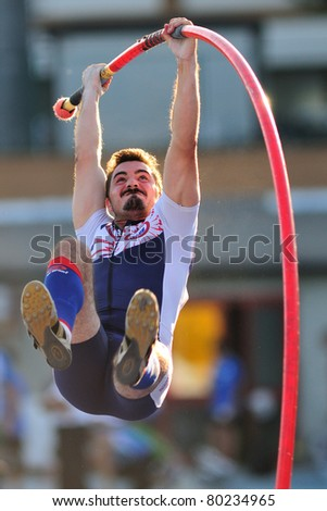 TURIN, ITALY - JUNE 25: MENZ Manfred jumps at men's pole vault during the 2011 Summer Track and Field Italian Championship meeting on June 25, 2011 in Turin, Italy. - stock photo