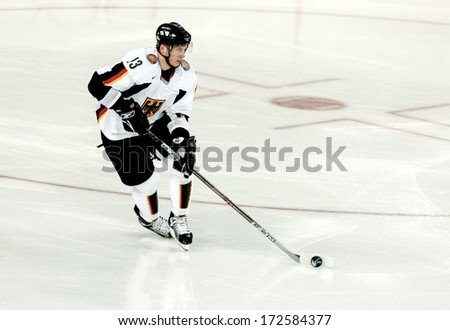 TURIN ITALY - MARCH 28: Ice Hockey German player during the Winter Olympic Games in Turin March 28, 2006.  - stock photo