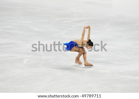 TURIN, ITALY - MARCH 27: Professional skater Yu-Na KIM from Korea performs free skating during the 2010 World Figure Skating Championship on March 27, 2010 in Turin, Italy. - stock photo