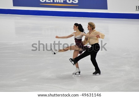 TURIN, ITALY - MARCH 26: Professional USA skaters Meryl DAVIS & Charlie WHITE perform free dance during the 2010 World Figure Skating Championship on March 26, 2010 in Turin, Italy. - stock photo