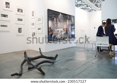TURIN, ITALY - NOVEMBER 06: Artissima 2014, people and art collectors at contemporary art fair vernissage on November 6, 2014 in Turin.  - stock photo